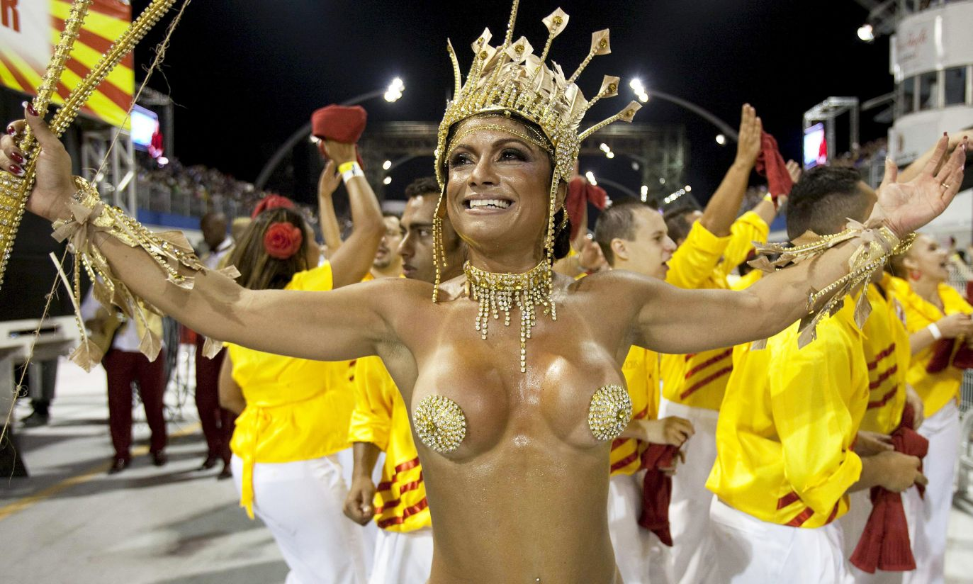 Topless rio carnival dancers dazzle in skimpy outfits for raunchy street parties