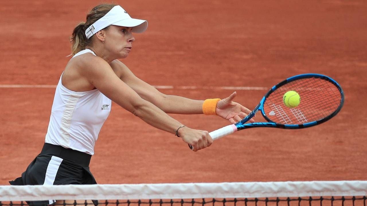 Magda Linette po raz pierwszy w karierze dotarła do półfinału w wielkoszlemowej rywalizacji (fot. PAP/EPA/CHRISTOPHE PETIT TESSON)
